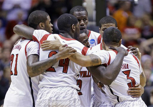 Louisville players huddle as guard Kevin Ware is treated for an injury during the first half of the Midwest Regional final against Duke in the NCAA college basketball tournament, Sunday, March 31, 2013, in Indianapolis. &#40;AP Photo&#47;Michael Conroy&#41; <span class=meta>(AP Photo&#47; Michael Conroy)</span>