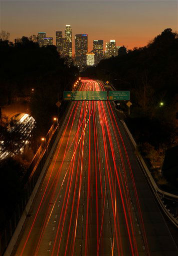 "<div class=""meta ""><span class=""caption-text "">Cars move toward downtown Los Angeles on the 110 Harbor Freeway, Wednesday, Nov. 21, 2012, in Los Angeles. Millions of Americans piled their families into cars, hopped on buses and waited out delays at airports Wednesday as they set off on Thanksgiving treks that many said required financial sacrifice, help from relatives to come up with airfare and hours searching online for deals. (AP Photo/Mark J. Terrill) (AP Photo/ Mark J. Terrill)</span></div>"