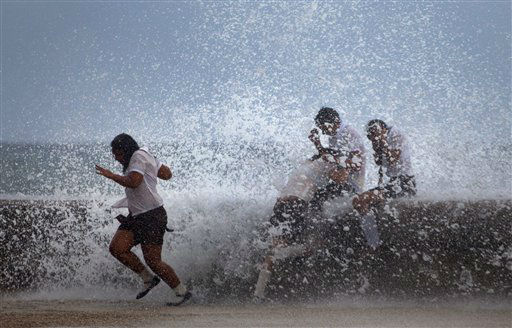 Students play in the waves crashing against the Malecon after the passing of Hurricane Sandy in Havana, Cuba, Thursday, Oct. 25, 2012. Hurricane Sandy blasted across eastern Cuba on Thursday as a potent Category 2 storm and headed for the Bahamas after causing at least two deaths in the Caribbean. &#40;AP Photo&#47;Ramon Espinosa&#41; <span class=meta>(AP Photo&#47; Ramon Espinosa)</span>