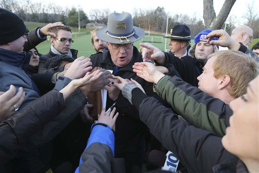 Lt. J. Paul Vance of the Connecticut State Police is surrounded by reporters as he hands out the list of victims of the shooting at the Sandy Hook Elementary School,  Saturday, Dec. 15, 2012 in Sandy Hook village of Newtown, Conn.  The victims of the shooting were shot multiple times by semiautomatic rifle, according to Connecticut Chief Medical Examiner  H. Wayne Carver II, M.D.  Carver called the injuries &#34;devastating&#34; and the worst he and colleagues had ever seen. Police began releasing the identities of the dead. All of the 20 children killed were 6 or 7 years old. Carver, said he examined seven of the children killed, and two had been shot at close range. When asked how many bullets were fired, he said, &#34;I&#39;m lucky if I can tell you how many I found.&#34; &#40;AP Photo&#47;Mary Altaffer&#41; <span class=meta>(AP Photo&#47; Mary Altaffer)</span>