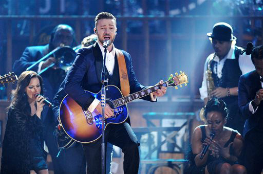 Justin Timberlake, center, performs on stage at the American Music Awards at the Nokia Theatre L.A. Live on Sunday, Nov. 24, 2013, in Los Angeles. (Photo by John Shearer/Invision/AP)