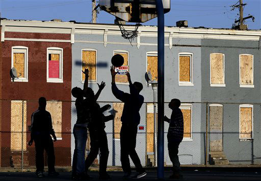 Children play basketball at a park near blighted row houses in Baltimore, Monday, April 1, 2013. Baltimore is far from the worst American city for poverty, but it faces all the problems of cities where vast numbers of the poor now live. The U.S. Census Bureau puts the number of Americans in poverty at levels not seen since the mid-1960s, while &#36;85 billion in federal government spending cuts that began last month are expected to begin squeezing services for the poor nationwide. &#40;AP Photo&#47;Patrick Semansky&#41; <span class=meta>(AP Photo&#47; Patrick Semansky)</span>
