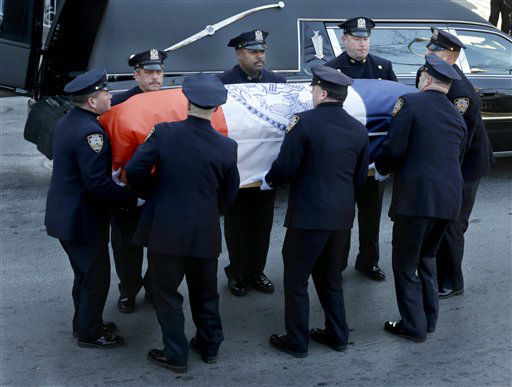 "<div class=""meta image-caption""><div class=""origin-logo origin-image ""><span></span></div><span class=""caption-text"">The casket containing the body of former New York City Mayor Ed Koch is arrives at Temple Emanu-El for his funeral in New York, Monday, Feb. 4, 2013.  Koch died Friday of congestive heart failure at age 88.  (AP Photo/Seth Wenig) (AP Photo/ Seth Wenig)</span></div>"