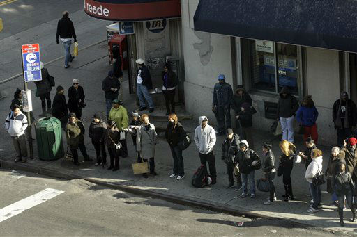 "<div class=""meta ""><span class=""caption-text "">Commuters wait for busses near the Long Island Rail Road Jamaica Station Thursday, Nov. 1, 2012, in the New York City borough of Queens. Three days after superstorm Sandy made landfall, residents and commuters still faced obstacles as they tried to return to pre-storm routines. (AP Photo/Frank Franklin II) (AP Photo/ Frank Franklin II)</span></div>"