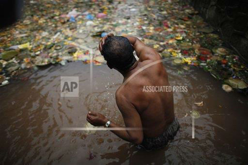 "<div class=""meta image-caption""><div class=""origin-logo origin-image ""><span></span></div><span class=""caption-text"">A Nepalese Hindu man takes a holy dip in a pond during Matatirtha Aunshi or Mother?s Day at Matatirtha Temple, in Katmandu, Nepal, Thursday, May 9, 2013. On this day, Nepalese Hindus pronounce their affection for their deceased mothers by performing the holy bathing ritual. (AP Photo/Niranjan Shrestha)  </span></div>"