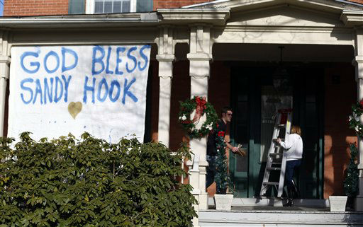 "<div class=""meta ""><span class=""caption-text "">People collect items used to hang a message written on fabric at a home a day after a gunman opened fire at Sandy Hook Elementary School, Saturday, Dec. 15, 2012, in the Sandy Hook village of Newtown, Conn.  The massacre of 26 children and adults at Sandy Hook Elementary school elicited horror and soul-searching around the world even as it raised more basic questions about why the gunman, 20-year-old Adam Lanza, would have been driven to such a crime and how he chose his victims.  (AP Photo/Julio Cortez) (AP Photo/ Julio Cortez)</span></div>"