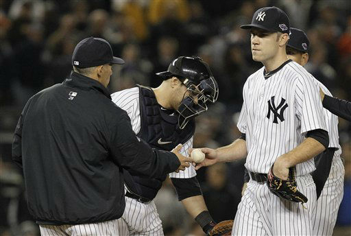 "<div class=""meta ""><span class=""caption-text "">New York Yankees manager Joe Girardi takes relief pitcher David Phelps out of the game during the 13th inning of Game 4 of the American League division baseball series against the Baltimore Orioles on Thursday, Oct. 11, 2012, in New York. The Orioles won 2-1. (AP Photo/Kathy Willens) (AP Photo/ Kathy Willens)</span></div>"