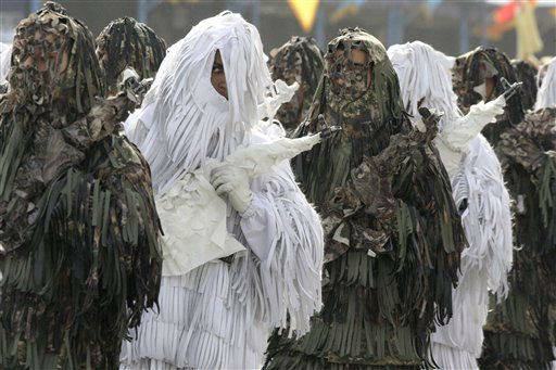 "<div class=""meta ""><span class=""caption-text "">Wearing ghilli suits, Iranian army troops march in a parade marking National Army Day in front of the mausoleum of the late revolutionary founder Ayatollah Khomeini, just outside Tehran, Iran, Thursday, April 18, 2013. Ahead of the parade, Iran's President Mahmoud Ahmadinejad slammed ""foreign presence"" in the Persian Gulf, claiming it's the source of insecurity in the region. (AP Photo/Vahid Salemi) (AP Photo/ Vahid Salemi)</span></div>"