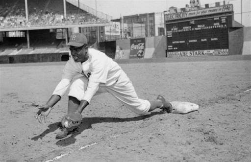 "<div class=""meta image-caption""><div class=""origin-logo origin-image ""><span></span></div><span class=""caption-text"">Jackie Robinson, Brooklyn Dodgers' first baseman, is shown at Ebbets Field, April 11, 1947.  (AP Photo) (AP Photo/ XKC)</span></div>"