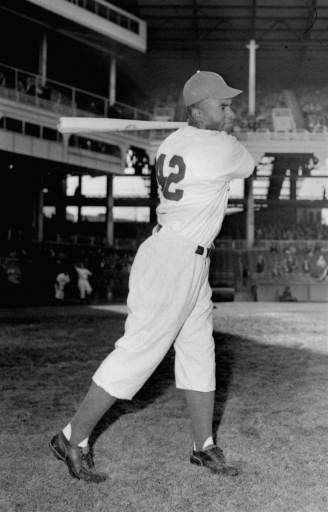 "<div class=""meta ""><span class=""caption-text "">Jackie Robinson, Brooklyn Dodgers' first baseman, posed action at Ebbets Field, April 11, 1947.  (AP Photo) (AP Photo/ XKC)</span></div>"