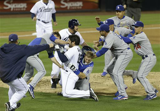 San Diego Padres&#39; Carlos Quentin charges into Los Angeles Dodgers  pitcher Zack Greinke after being hit by a pitch in the sixth inning of baseball game in San Diego, Thursday, April 11, 2013. &#40;AP Photo&#47;Lenny Ignelzi&#41; <span class=meta>(AP Photo&#47; Lenny Ignelzi)</span>
