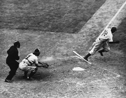 The Dodgers&#39; Jackie Robinson drops bat and takes off for first after bunting safely in the fifth inning of the game with the giants at Ebbets Field, July 3, 1947 in New York. The Brooks lost 9-2. Walker Cooper is the catcher and Babe Pinelli is the Ump. &#40;AP Photo&#41; <span class=meta>(AP Photo&#47; N  PO. XJFM)</span>