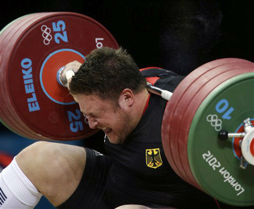 Matthias Steiner of Germany gets hit by the weights while failing to make a successful lift  in the men&#39;s over 105-kg, group A, weightlifting competition at the 2012 Summer Olympics, Tuesday, Aug. 7, 2012, in London. &#40;AP Photo&#47;Mike Groll&#41; <span class=meta>(AP Photo&#47; Mike Groll)</span>