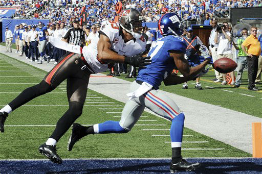 New York Giants cornerback Michael Coe &#40;37&#41; breaks up a pass to Tampa Bay Buccaneers&#39; Vincent Jackson &#40;83&#41; during the second half of an NFL football game on Sunday, Sept. 16, 2012, in East Rutherford, N.J. &#40;AP Photo&#47;Bill Kostroun&#41; <span class=meta>(AP Photo&#47; Bill Kostroun)</span>