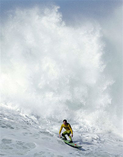 Colin Dwyer competes during heat 4 of the Mavericks Invitational big wave surf contest in Half Moon Bay, Calif., Sunday, Jan. 20, 2013. &#40;AP Photo&#47;Marcio Jose Sanchez&#41; <span class=meta>(AP Photo&#47; Marcio Jose Sanchez)</span>