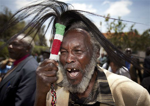 "<div class=""meta ""><span class=""caption-text "">Lawrence Mathenge, representative of the Mau Mau War Veterans Association, celebrates the announcement of a legal decision in Britain's High Court concerning Mau Mau veterans, while holding a ceremonial whisk, at the offices of the Kenya Human Rights Commission in Nairobi, Kenya Friday, Oct. 5, 2012. Britain's High Court ruled Friday that three Kenyans tortured during the Mau Mau rebellion against British colonial rule can proceed with compensation claims against the British government. (AP Photo/Ben Curtis) (AP Photo/ Ben Curtis)</span></div>"