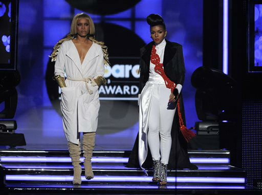 Erykah Badu, left, and Janelle Monae announce the icon award at the Billboard Music Awards at the MGM Grand Garden Arena on Sunday, May 19, 2013 in Las Vegas. &#40;Photo by Chris Pizzello&#47;Invision&#47;AP&#41; <span class=meta>(AP Photo&#47; Chris Pizzello)</span>