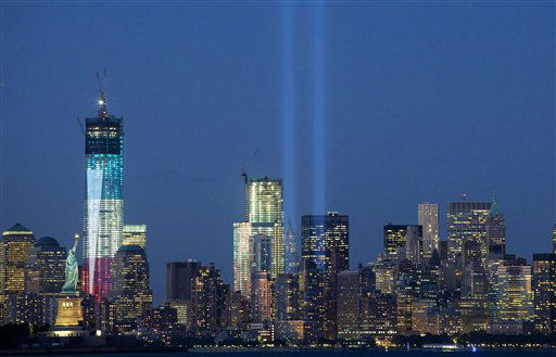 The Tribute in Light shines above the World Trade Center in New York and the Statue of Liberty, left, Monday, Sept. 10, 2012 in this photo taken from Bayonne, N.J. Tuesday will mark the eleventh anniversary of the terrorist attacks of Sept. 11, 2001.  The tallest tower is 1 World Trade Center, now up to 105 floors. In the center is 4 World Trade Center. &#40;AP Photo&#47;Mark Lennihan&#41; <span class=meta>(AP Photo&#47; Mark Lennihan)</span>