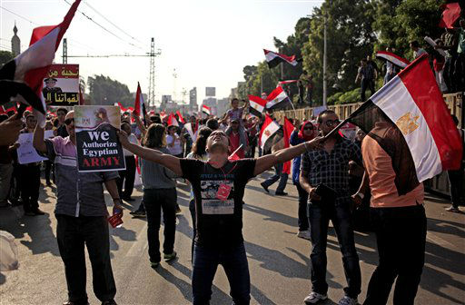 "<div class=""meta image-caption""><div class=""origin-logo origin-image ""><span></span></div><span class=""caption-text"">Opponents of Egypt's Islamist President Mohammed Morsi wave national flags during a protest outside the presidential palace, in Cairo, Egypt, Wednesday, July 3, 2013. The deadline on the military's ultimatum to President Mohammed Morsi has expired, with 48 hours passing since the time it was issued. Giant cheering crowds of Morsi's opponents have been gathered in Cairo's Tahrir Square and other locations nationwide, waving flags furiously in expection that the military will act to remove the Islamist president after the deadline ends. (AP Photo/Khalil Hamra) (AP Photo/ Khalil Hamra)</span></div>"