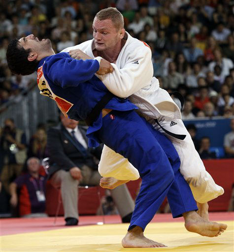 Tagir Khaibulaev of Russia, &#40;in blue&#41;, competes against Dimitri Peters of Germany during the men&#39;s under 100-kg judo competition at the 2012 Summer Olympics, Thursday, Aug. 2, 2012, in London. &#40;AP Photo&#47;Paul Sancya&#41; <span class=meta>(AP Photo&#47; Paul Sancya)</span>