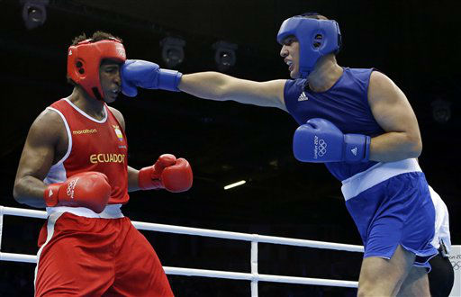 "<div class=""meta ""><span class=""caption-text "">Ecuador's Julio Castillo Torres, left, fights Belarus' Siarhei Karneyeu during a heavyweight 91-kg preliminary boxing match at the 2012 Summer Olympics, Wednesday, Aug. 1, 2012, in London. (AP Photo/Patrick Semansky) (AP Photo/ Patrick Semansky)</span></div>"