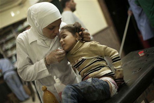 "<div class=""meta ""><span class=""caption-text "">In this Wednesday, Oct. 10, 2012 photo, a Syrian nurse treats a girl wounded by Syrian Army artillery shelling at Dar El Shifa hospital in Aleppo, Syria. (AP Photo/Manu Brabo) (AP Photo/ Manu Brabo)</span></div>"