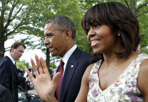 President Barack Obama and first lady Michelle leave after visiting Section 60 of Arlington National Cemetery on Memorial Day Monday, May 27, 2013, in Arlington, Va. &#40;AP Photo&#47;Molly Riley&#41; <span class=meta>(AP Photo&#47; Molly Riley)</span>