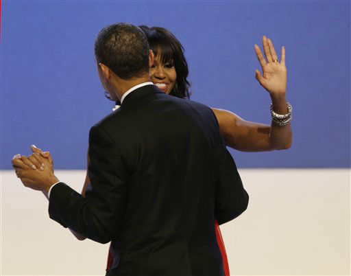"<div class=""meta ""><span class=""caption-text "">First lady Michelle Obama waves to guests while dancing with President Barack Obama during the Inaugural Ball at the 57th Presidential Inauguration in Washington, Monday, Jan. 21, 2013. (AP Photo/Paul Sancya) (AP Photo/ Paul Sancya)</span></div>"