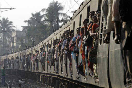 "<div class=""meta ""><span class=""caption-text "">Indian commuters travel in a local train in Kolkata, India, Tuesday, Feb. 26, 2013. Indian Railway Minister Pawan Kumar Bansal is presenting the country's rail budget for next fiscal year in the parliament Tuesday, Feb. 26, 2013. Indian railway network is one of the world's largest, with some 14 million passengers daily and some 64,000 kilometers (40,000 miles) of railway track cut through some of the most densely populated cities. (AP Photo/Bikas Das)</span></div>"