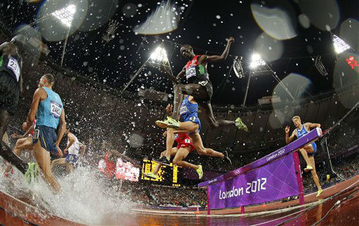 In this photo taken with a fisheye lens, Kenya&#39;s Ezekiel Kemboi clears the obstacle in the men&#39;s 3000-meter steeplechase final during the athletics in the Olympic Stadium at the 2012 Summer Olympics, London, Sunday, Aug. 5, 2012. &#40;AP Photo&#47;Matt Dunham&#41; <span class=meta>(AP Photo&#47; Matt Dunham)</span>