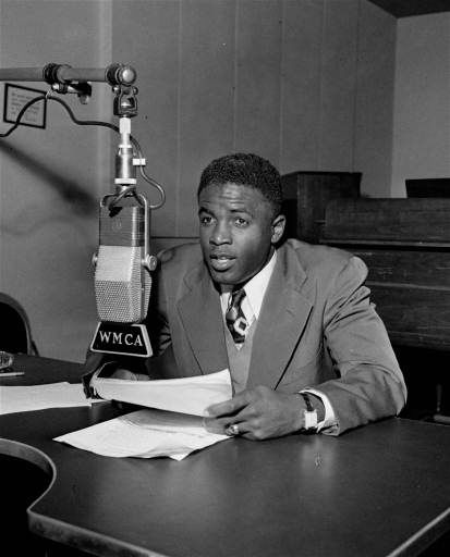 "<div class=""meta ""><span class=""caption-text "">Jackie Robinson, Brooklyn Dodgers infielder, makes his debut as a sportscaster for radio station WMCA in New York, November 15, 1948. Robinson will do a six-nights-a-week program which is sponsored.  (AP Photo) (AP Photo/ ML)</span></div>"