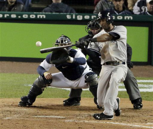 New York Yankees&#39; Eduardo Nunez hits a home run in the ninth inning during Game 3 of the American League championship series against the Detroit Tigers Tuesday, Oct. 16, 2012, in Detroit. &#40;AP Photo&#47;Charlie Riedel&#41; <span class=meta>(AP Photo&#47; Charlie Riedel)</span>