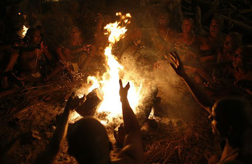 Hindu holy men make offerings to the fire as they chant mantras to be initiated as &#39;Naga sadhus&#39; or naked Hindu holy men at the Maha Kumbh festival in Allahabad, India, Wednesday, Feb. 13, 2013. The significance of nakedness is that one will not have any worldly ties to material belongings, even something as simple as clothes. Rituals that transform selected holy men to Naga can only be done at the Kumbh festival.&#40;AP Photo&#47; Saurabh Das&#41; <span class=meta>(AP Photo&#47; Saurabh Das)</span>