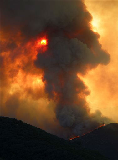 "<div class=""meta ""><span class=""caption-text "">Smoke billows from a fire burring in Point Mugu State Park during a wildfire that burned several thousand acres, Thursday, May 2, 2013, in Ventura County, Calif.   (AP Photo/Mark J. Terrill) (AP Photo/ Mark J. Terrill)</span></div>"