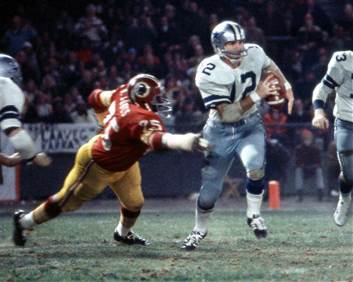 "<div class=""meta ""><span class=""caption-text "">Washington Redskins Hall of Fame defensive end David ""Deacon"" Jones (75) pressures Dallas Cowboys Hall of Fame quarterback Roger Staubach (12) during game in Los Angeles, Nov. 17, 1974. The Redskins defeated the Cowboys 28-21 at RFK Stadium.  (AP Photo/NFL Photos) (AP Photo/ Uncredited)</span></div>"
