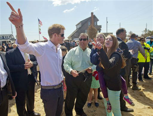 Britain&#39;s Prince Harry and N..J. Gov. Chris Christie talk with members of the the Bowden family on their empty lot in Mantoloking, N.J. on Tuesday, May 14, 2013.  Prince Harry began a tour Tuesday of New Jersey?s storm-damaged coastline, inspecting dune construction, walking past destroyed homes and shaking hands with police and other emergency workers.  &#40;AP Photo&#47;The Star-Ledger, Andrew Mills, Pool&#41; <span class=meta>(AP Photo&#47; Andrew Mills)</span>