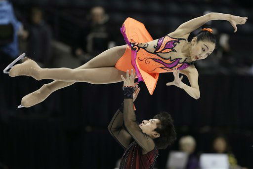 Sui Wenjing and Han Cong, of China, perform during the pairs short program at the World Figure Skating Championships Wednesday, March 13, 2013, in London, Ontario. (AP Photo/Darron Cummings)