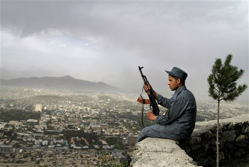 An Afghan policeman sits on a wall on a mountain overlooking Kabul, Afghanistan, Wednesday, May, 22, 2013. &#40;AP Photo&#47;Ahmad Jamshid&#41; <span class=meta>(AP Photo&#47; Ahmad Jamshid)</span>