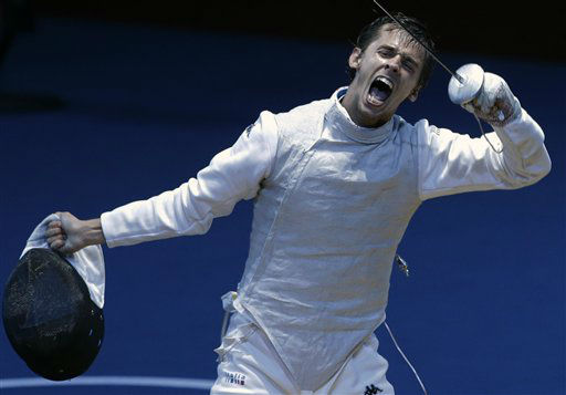 Andrea Baldini of Italy reacts after his match against Alexey Cheremisinov of Russia during men&#39;s individual foil fencing at the 2012 Summer Olympics, Tuesday, July 31, 2012, in London. &#40;AP Photo&#47;Andrew Medichini&#41; <span class=meta>(AP Photo&#47; Andrew Medichini)</span>