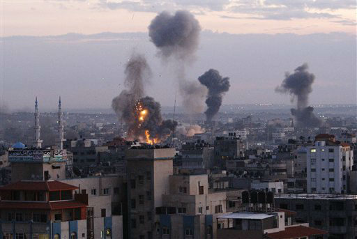 "<div class=""meta ""><span class=""caption-text "">Columns of smoke rise following an Israeli air strike in Gaza City, Wednesday, Nov. 14, 2012. Palestinian witnesses say Israeli airstrikes have hit a series of targets across Gaza City, shortly after the assassination of the top Hamas commander. Hamas security officials say two Hamas training facilities were among the targets in the Wednesday afternoon bombings. (AP Photo/Adel Hana) (AP Photo/ Adel Hana)</span></div>"