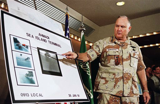 FILE - In this Jan. 27, 1991 file photo, U.S. Army Gen. Norman Schwarzkopf points to row of photos of Kuwait&#39;s Ahmadi Sea Island Terminal on fire after a U.S. attack on the facility. Schwarzkopf died Thursday, Dec. 27, 2012 in Tampa, Fla. He was 78. &#40;AP Photo&#47;Laurent Rebours, File&#41; <span class=meta>(AP Photo&#47; Laurent Rebours)</span>