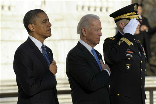 President Barack Obama and Vice President Joe Biden, accompanied by Maj. Gen. Michael S. Linnington, Commander of the U.S. Army Military District of Washington, listen to Taps after placing a wreath at the Tomb of the Unknowns at Arlington National Cemetery in Arlington, Va., Sunday, Jan. 20, 2013.  &#40;AP Photo&#47;Susan Walsh&#41; <span class=meta>(AP Photo&#47; Susan Walsh)</span>