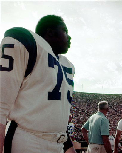 "<div class=""meta ""><span class=""caption-text "">Los Angeles Rams Hall of Fame defensive end David ""Deacon"" Jones (75) watches from the sideliness during game in Los Angeles, 1970s.   (AP Photo/NFL Photos) (AP Photo/ Uncredited)</span></div>"