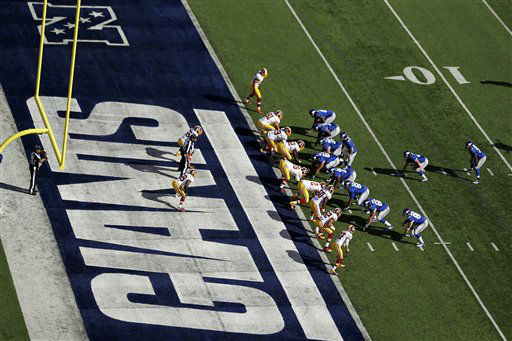 The Washington Redskins, left, play the New York Giants during the first half of an NFL football game Sunday, Oct. 21, 2012 in East Rutherford, N.J. &#40;AP Photo&#47;Julio Cortez&#41; <span class=meta>(AP Photo&#47; Julio Cortez)</span>