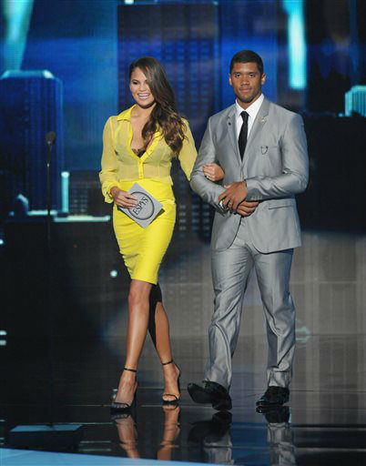 Chrissy Teigen, left, and NFL player Russell Wilson walk on stage to present an award at the ESPY Awards on Wednesday, July 17, 2013, at Nokia Theater in Los Angeles. &#40;Photo by John Shearer&#47;Invision&#47;AP&#41; <span class=meta>(Photo&#47;John Shearer)</span>