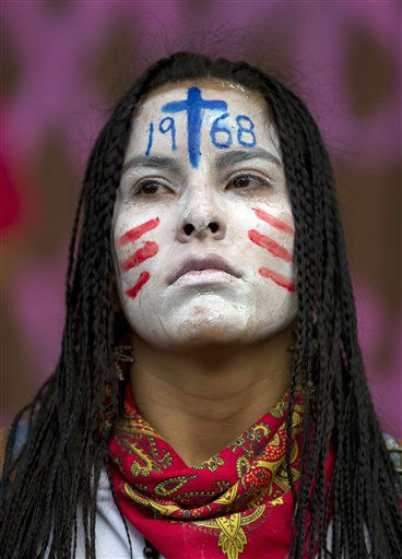 A student with her face painted attends a march marking the 44th anniversary of the Tlatelolco massacre in Mexico City, Tuesday Oct. 2, 2012. On Oct. 2, 1968, soldiers opened fire against a student demonstration in Mexico City&#39;s Tlatelolco Plaza just before the capital hosted the Olympics. Official reports said 25 people were killed, but human rights activists say as many as 350 may have died. &#40;AP Photo&#47;Eduardo Verdugo&#41; <span class=meta>(AP Photo&#47; Eduardo Verdugo)</span>