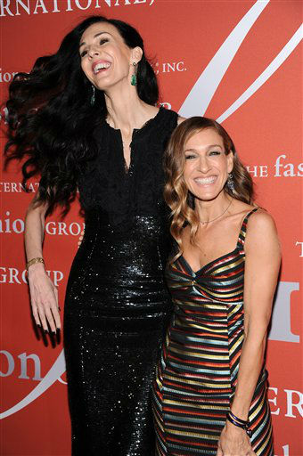 "<div class=""meta ""><span class=""caption-text "">Actress Sarah Jessica Parker poses with honoree L'Wren Scott at the 29th Annual ""Night Of Stars"" presented by The Fashion Group International at Cipriani Wall Street on Thursday Oct. 25, 2012 in New York. (Photo by Evan Agostini/Invision/AP) (Photo/Evan Agostini)</span></div>"