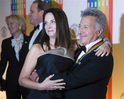 Kennedy Center Honoree Dustin Hoffman arrives with his wife, Lisa, at the Kennedy Center for the Performing Arts for the 2012 Kennedy Center Honors Performance and Gala Sunday, Dec. 2, 2012 at the State Department in Washington. &#40;AP Photo&#47;Kevin Wolf&#41; <span class=meta>(AP Photo&#47; Kevin Wolf)</span>