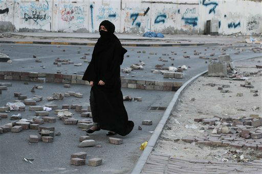 "<div class=""meta ""><span class=""caption-text "">A Bahraini anti-government protester walks on a street filled with bricks meant to slow down riot police vehicles during clashes in Manama, Bahrain, Monday, Feb. 25, 2013. Protesters tried from several directions to reach the country's main public hospital, which is heavily guarded, to forcibly claim for burial the body of a 20-year-old who died Thursday from injuries sustained during earlier clashes with police. (AP Photo/Hasan Jamali)</span></div>"