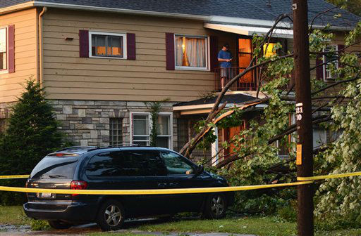 "<div class=""meta image-caption""><div class=""origin-logo origin-image ""><span></span></div><span class=""caption-text"">A man uses his phone from a balcony after a possible tornado struck Emira N.Y., Thursday, July 26, 2012. The storm brought down trees and power lines, tore roofs off some buildings and caused motor vehicle accidents. (AP Photo/Heather Ainsworth) (AP Photo/ Heather Ainsworth)</span></div>"